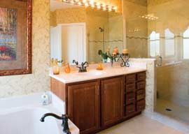 Luxury baths feature dual vanity sinks, roman tubs and glass enclosed showers