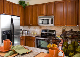 Select upgrade appliances, counters, fixtures and cabinetry for your new kitchen